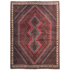 Vintage Persian Hand Knotted Tribal Red Repeated Medallion Shiraz Rug circa 1960