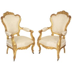 Pair of continental Napoleon III gilt wood armchairs