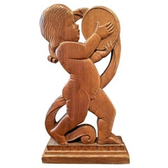 """Baby with Tambourine,"" Large, Finely-Carved Art Deco Sculpture in Walnut"