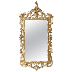 Superbly-Carved English George II Giltwood Mirror with Elaborate Foliate Crest
