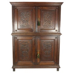 Oak Louis XV Style Four-Door Cabinet, circa 1810