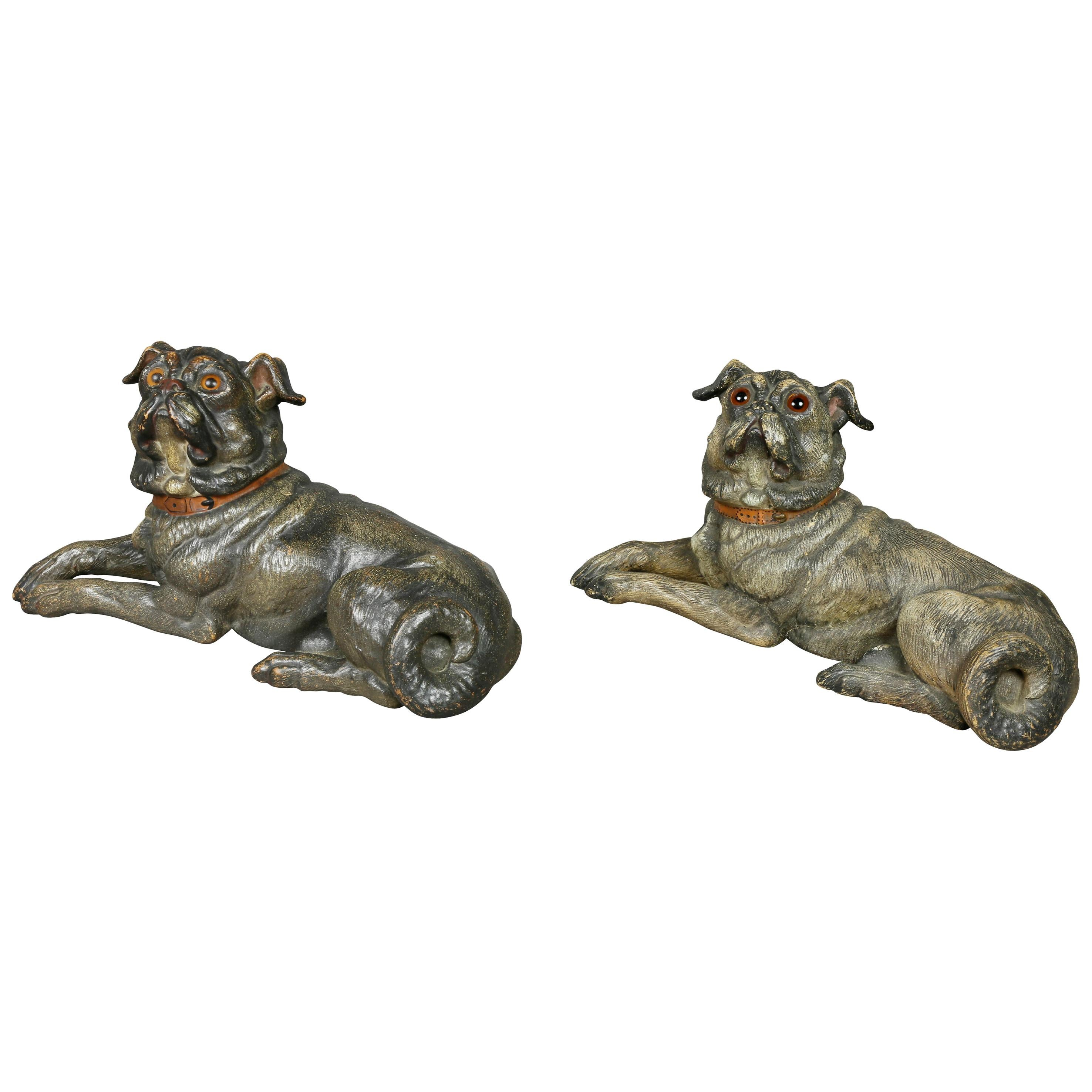 Two Terracotta Figures of Reclining Pug Dogs