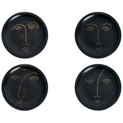 Four Ceramic Decorative Plates with Faces Signed by Dalo