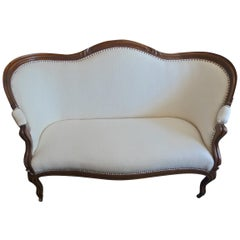 English Stained Walnut Love Seat with White Woven Cotton on Four Wood Castors
