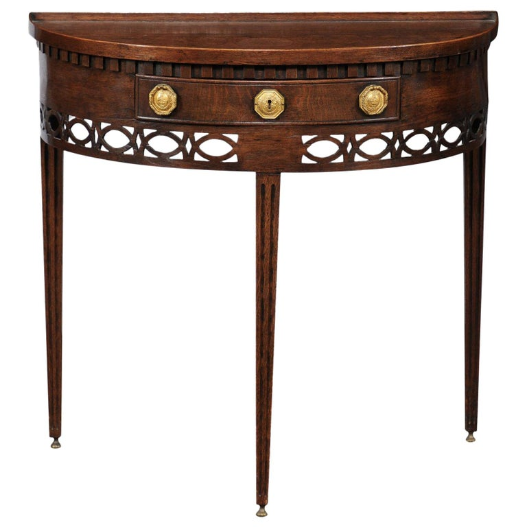 English 1860s Oak Demilune Table With Drawer Tapered Legs And Pierced Motifs For