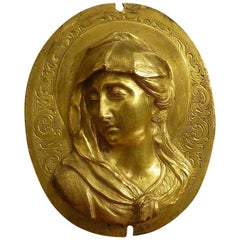 Oval Plaque in High Relief in Gilded Bronze