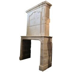 18th Century Hand Carved Limestone Fireplace Mantle with Trumeau from Provence