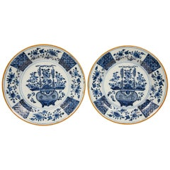 Pair of Blue and White Delft Chargers Showing a Flower Filled Vase