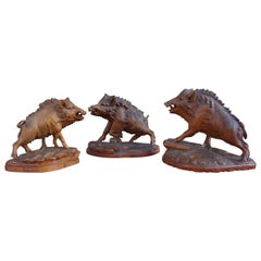 Group of Three Hand Carved Swiss Black Forest Wild Boar Sculptures by N. Deneffe