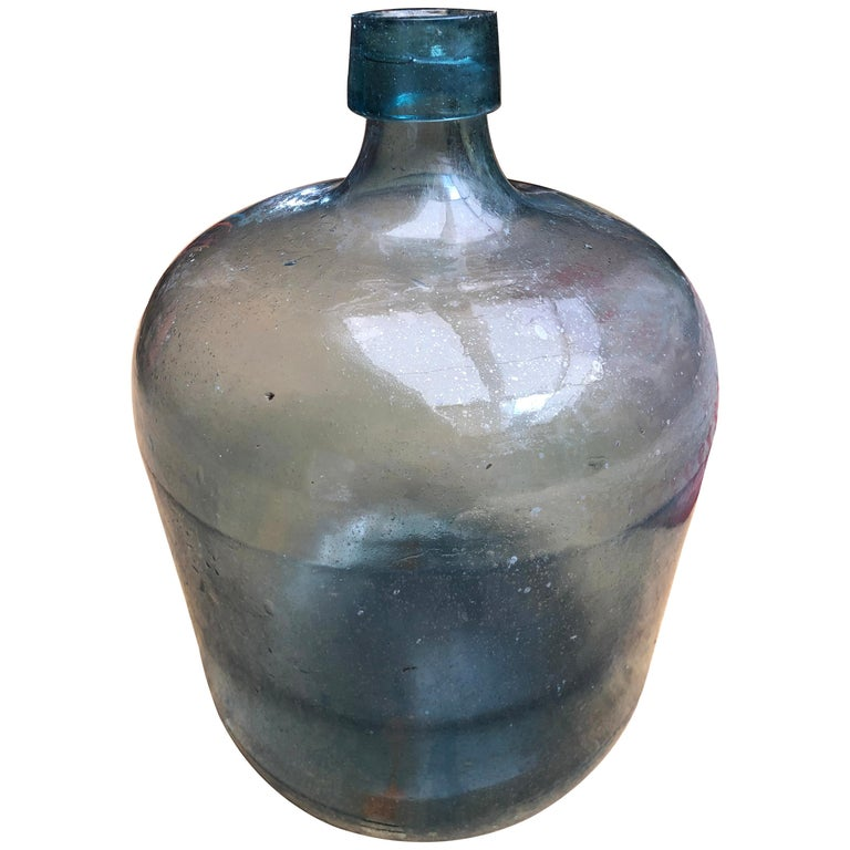 This unique piece is a rare to find because of its size. It was used to store tequila in the haciendas.