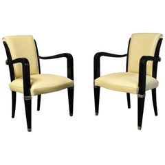 Pair of Art Deco Leather and Polished Ebonized Frame Armchairs