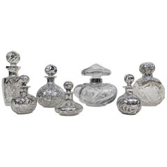 Collection of Seven Perfume Bottles circa 1890s Silver Overlay on Glass Baccarat