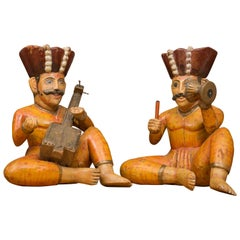 Raj Figures Playing Musical Instruments