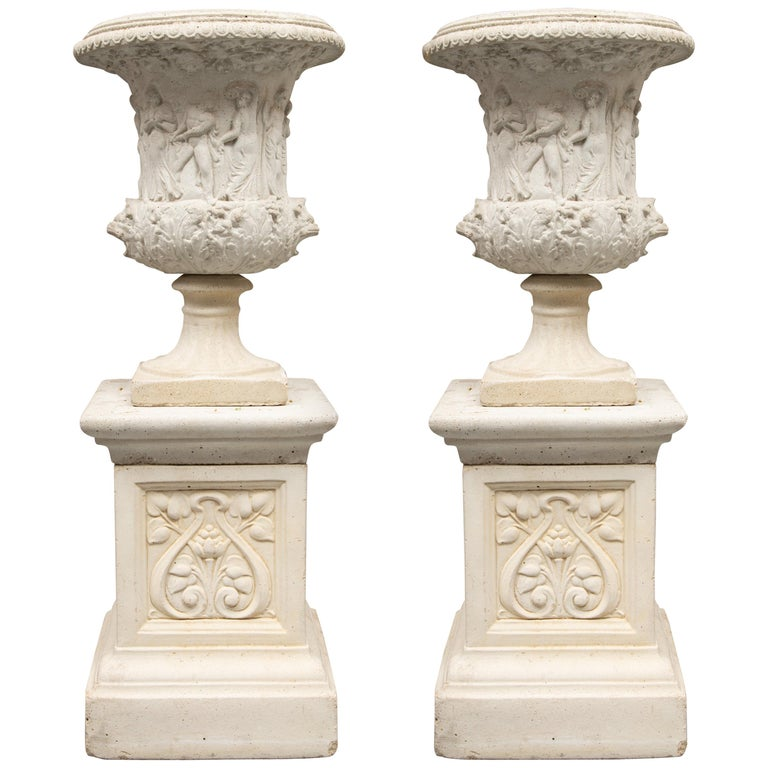 Pair of Cast Neoclassical Urns on Plinths For Sale