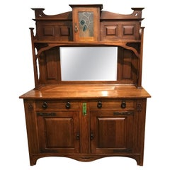 English Arts & Crafts Oak Sideboard with Stained Glass and Carved Decoration