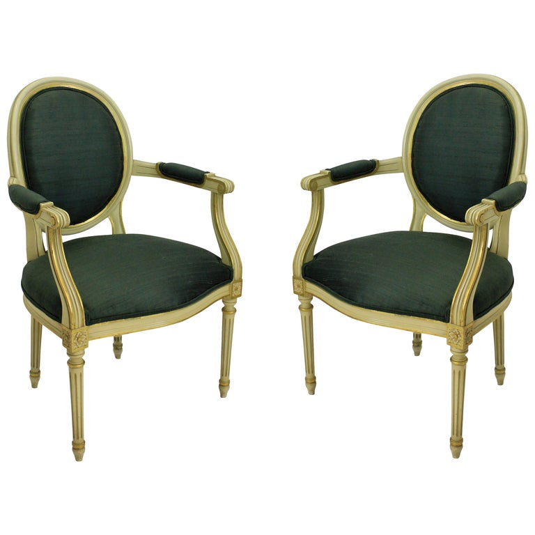 Pair of French Painted and Gilded Armchairs For Sale