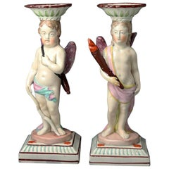 Antique Staffordshire Pottery Candlestick Figures of Cupid and a Putti