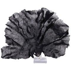 Large Black Fishnet Sponge on Lucite