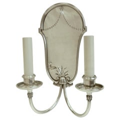 Set of Four Mirrored Back Silver Plated Two-Light Sconces by E. F. Caldwell