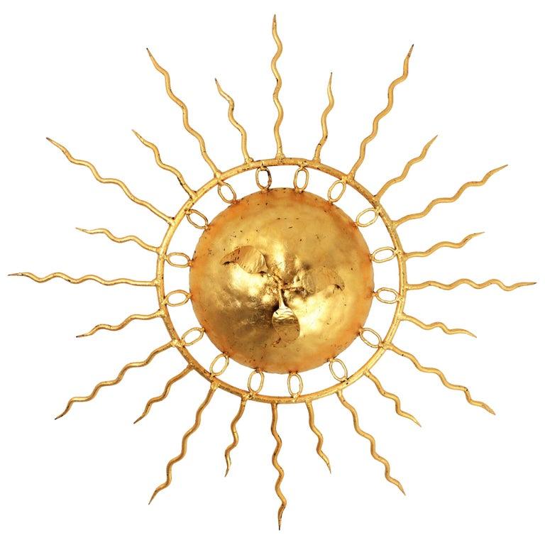 Brutalist Hand-Hammered Gold Gilt Iron Sunburst Light Fixture Framed By Circles For Sale