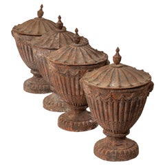 Set of Four 19th Century Neoclassical Cast Iron Garden Urns