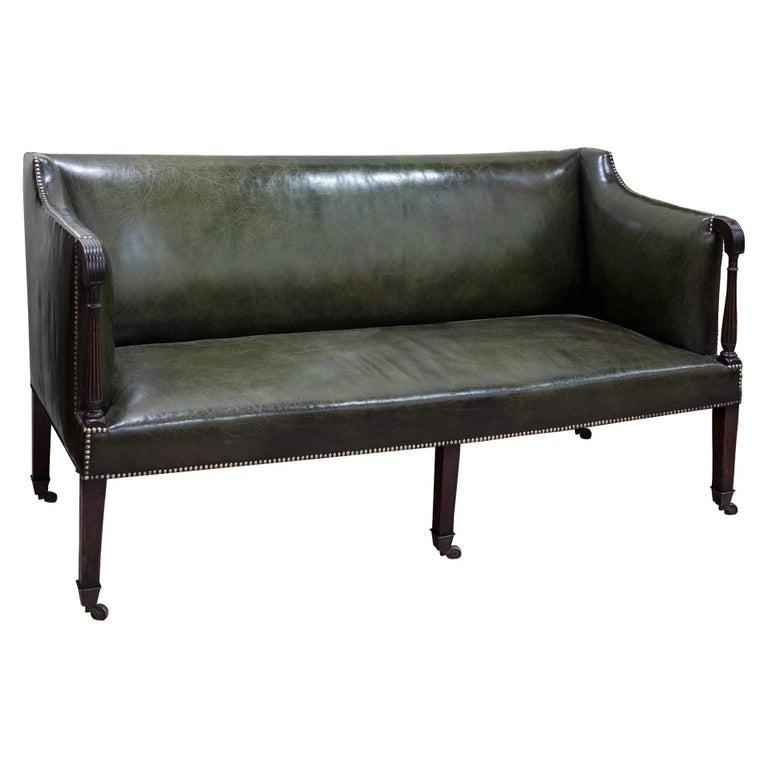 George III Dark Green Leather Sofa with Brass Castors, circa 1800