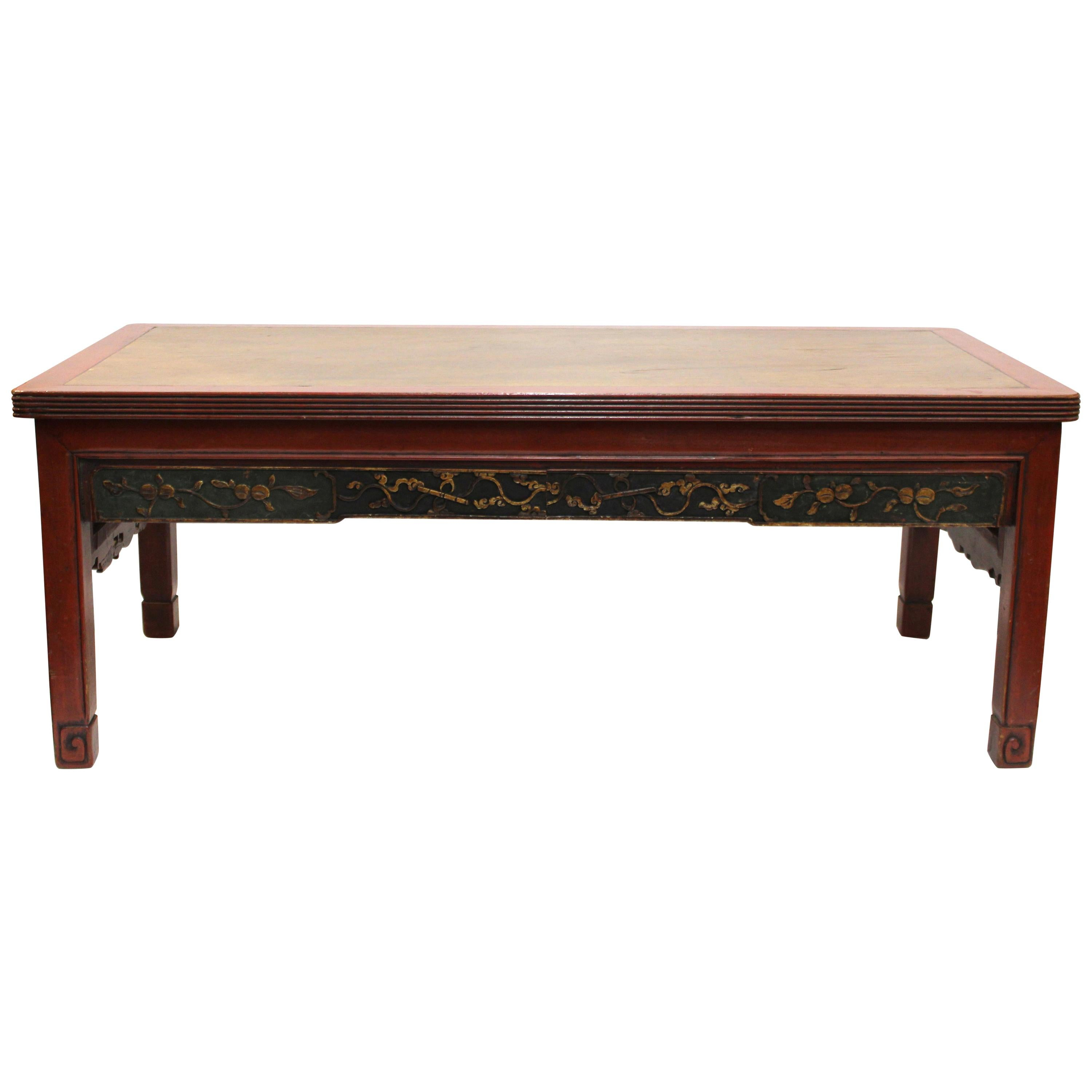 Chinese Carved Wood Cocktail Table In Red And Gold For Sale