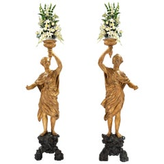 A true pair of Italian 18th century Venetian giltwood and polychrome torchières