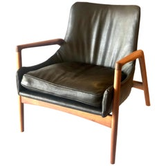 Danish Modern Leather and Walnut Lounge Armchair by Kofod Larsen