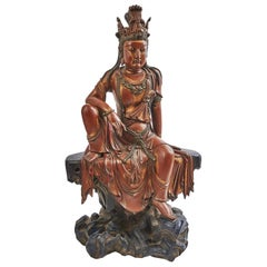 Chinese Red, Green and Gold Lacquered Carved Figure of Guanyin, circa 1900