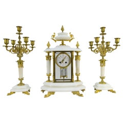 French Ormolu and White Marble Mantel Clock and Candelabra Set by A.D. Mougin