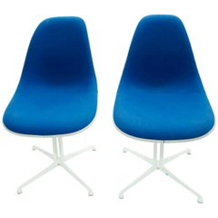 Pair of Charles and Ray Eames La Fonda Chairs with Cream White Fiberglass Shells