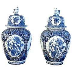 Pair of 19th Century Blue and White Lidded Vases