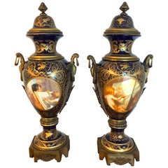 Pair of Palace Size Sevres Style 'Labors of Cupid' Ormolu & Cobalt Urns