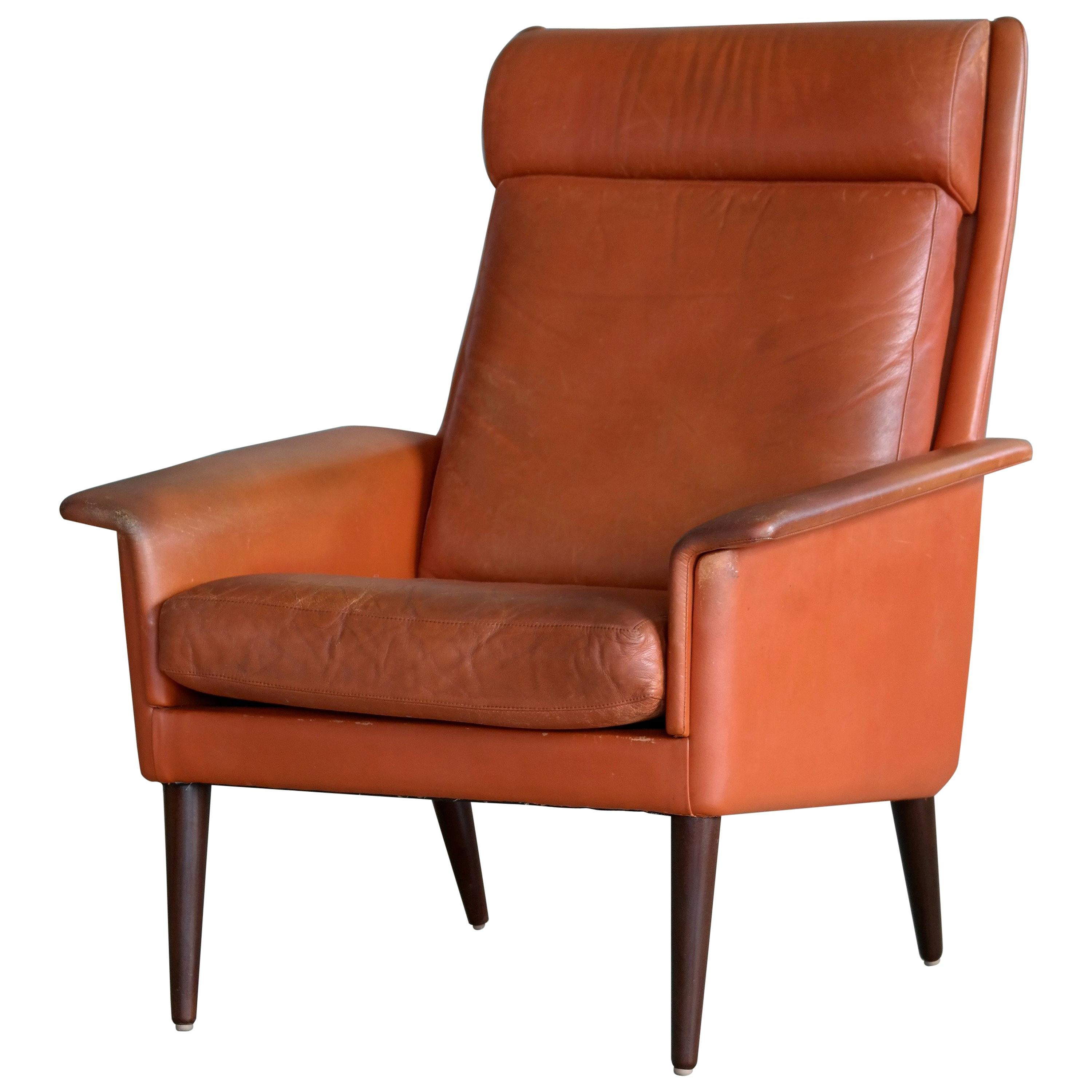 Danish Midcentury Cognac Colored High Back Lounge Chair by Sibast
