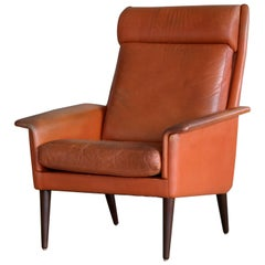 Danish Midcentury Cognac Colored High Back Lounge Chair with Ottoman by Spottrup