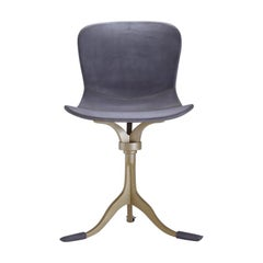 Bespoke Swivel Chair, Leather and Hand Cast Bass Base by P. Tendercool