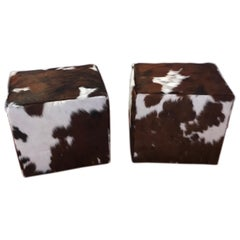 Pair of Cow Hide Benches or Ottomans