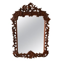 Large French Mirror in Hand Carved Solid Nutwood Frame with Flowery Decor