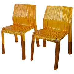 Pair of Italian Orange Chairs by Kartell