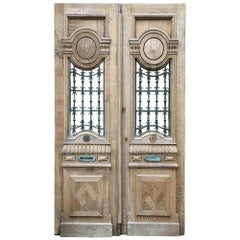 Pair of 19th Century Carved and Stripped Oak Doors with Wrought Iron
