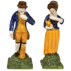Staffordshire Pearlware Figures of Man & Woman with a Pet Dog & Cat, circa 1810