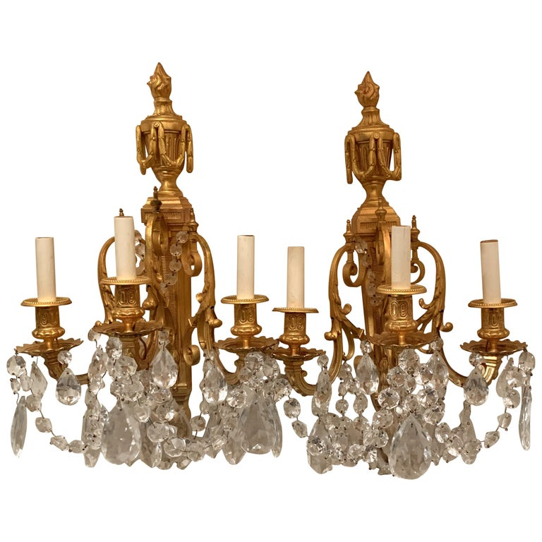 Wonderful French Neoclassical Pair of Doré Bronze Crystal Swag Urn Flame Sconces For Sale