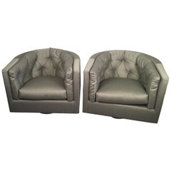 Pair of Swiveling Barrel-Back Chairs