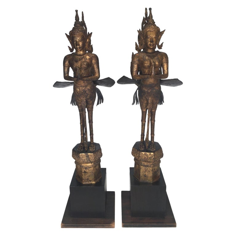 Pair of Antique Thai Winged Goddess Statues For Sale