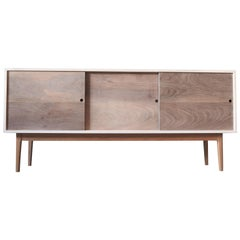 White Sideboard with Sliding walnut Doors and a solid maple base by MSJ Studio