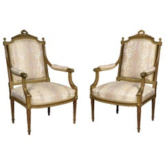 Pair of French Louis XVI Style Giltwood Armchairs