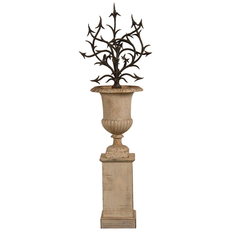 Antique French Hand Forged Iron Sculpture Set in an Iron Urn France, circa 1880 For Sale