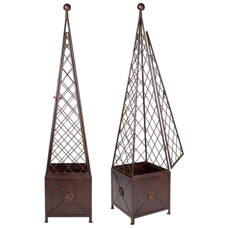 Pair of Classical French Style Iron Obelisks with Base For Sale
