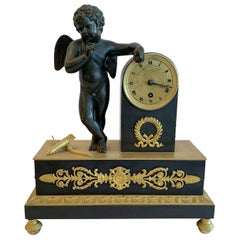 Wonderful French Empire Dore and Patinated Bronze Cherub Putti Wreath Clock